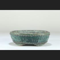 緑釉窯変鋲打楕円